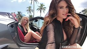 Glamorus babes are eating each others pussies in a convertible