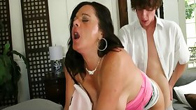 busty brunette MILF screwed in doggy by younger stud