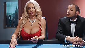 Silicone blonde Nicolette Shea blows hard penis during a threesome