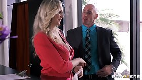 Busty journo Julia Ann drops on her knees with please her boss